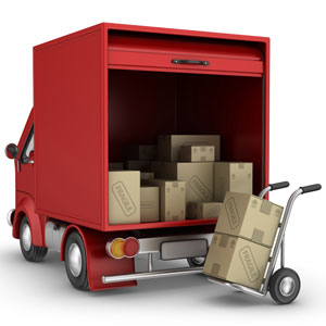 a red delivery van with a hand truck and cardboard boxes